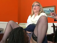 Nathan Threat gives Nina Hartley a glimpse of his mighty pecker and then licks her pussy, hoping that later she will bend down and let him in. Sexy milf knows no shame.