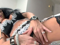 Arousing and hot busty brunette milf Vanilla Deville in sexy black and white lingerie and stockings enjoys in playing with her pussy and her alluring large melons for cam