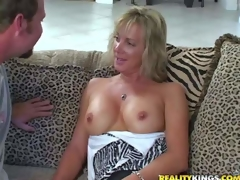 Shes one attractive tall milf blonde with slender figure. That babe gets enticed by MILF Hunter and goes topless. This woman is proud of her sexy well shaped firm tits. Man licks her nipps juts like crazy
