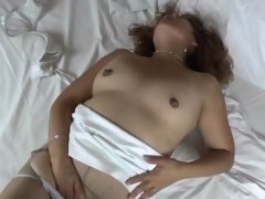 Solo mom in torn pantyhose masturbates
