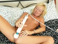 Tight body blonde mature gets naked and masturbates