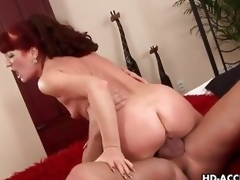 Mature redhead rides her pussy on this thick cock