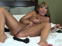 The brunette female-dominator enjoys every moment of the intense masturbation session