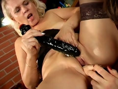 Trashy lesbo grannies Marketa And Leona licking their succulent pussies and sharing a giant dildo