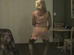 Mature golden-haired milf dancing and gets her large tits out and flashes her pussy too.
