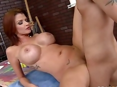 Milfy pornstar Joslyn James with red hair and biggest bumpers has a good time with one of her fans who finds his hard cock in her experienced mouth and then unfathomable inside her hot moist pussy.